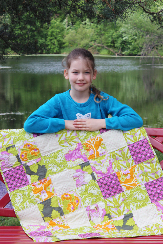 Gwyneth and her first quilt