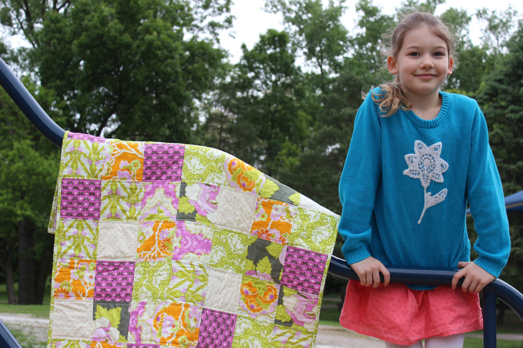 Gwyn with her first quilt